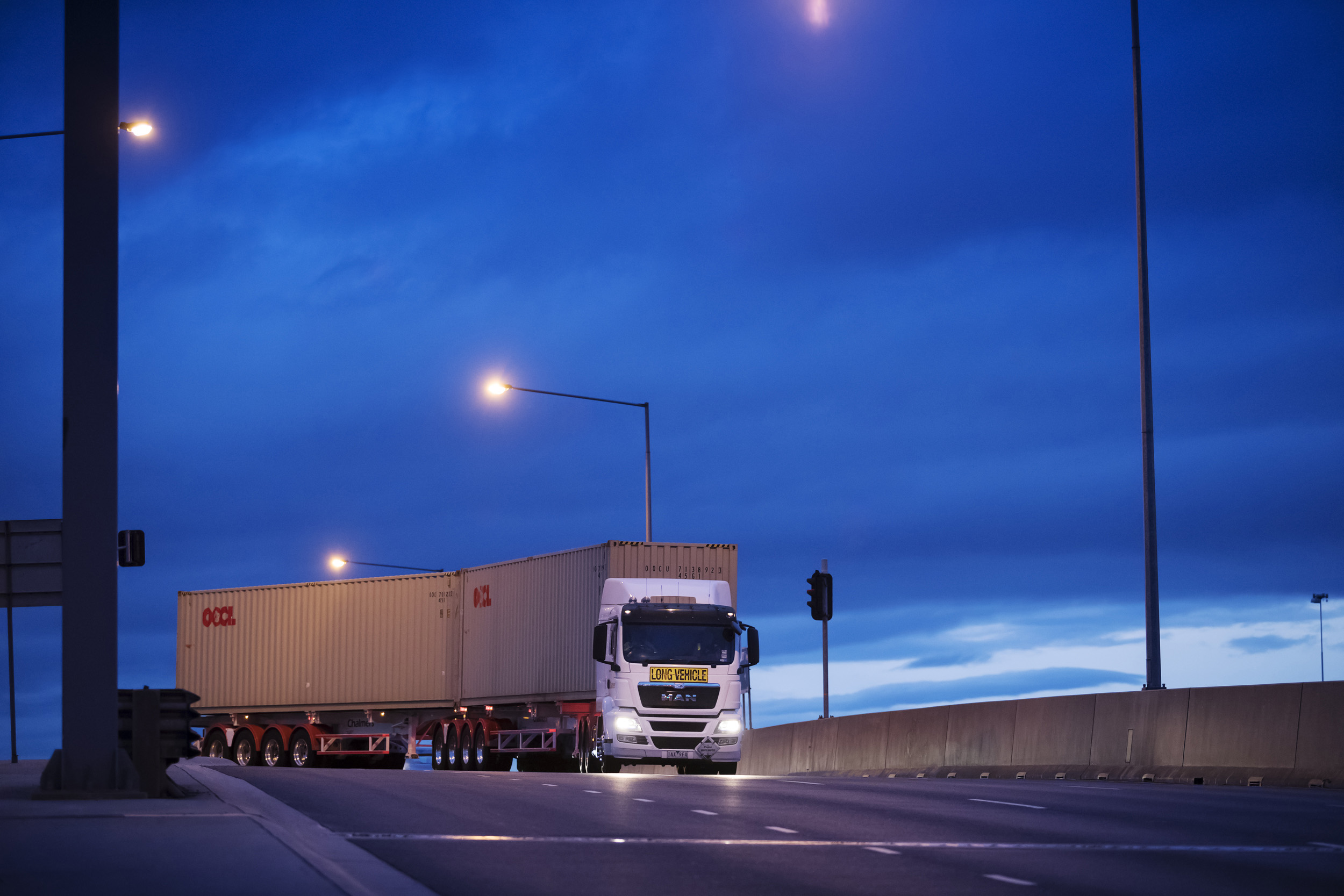 An MAN truck turning a corner at night. Paul Scott, industry